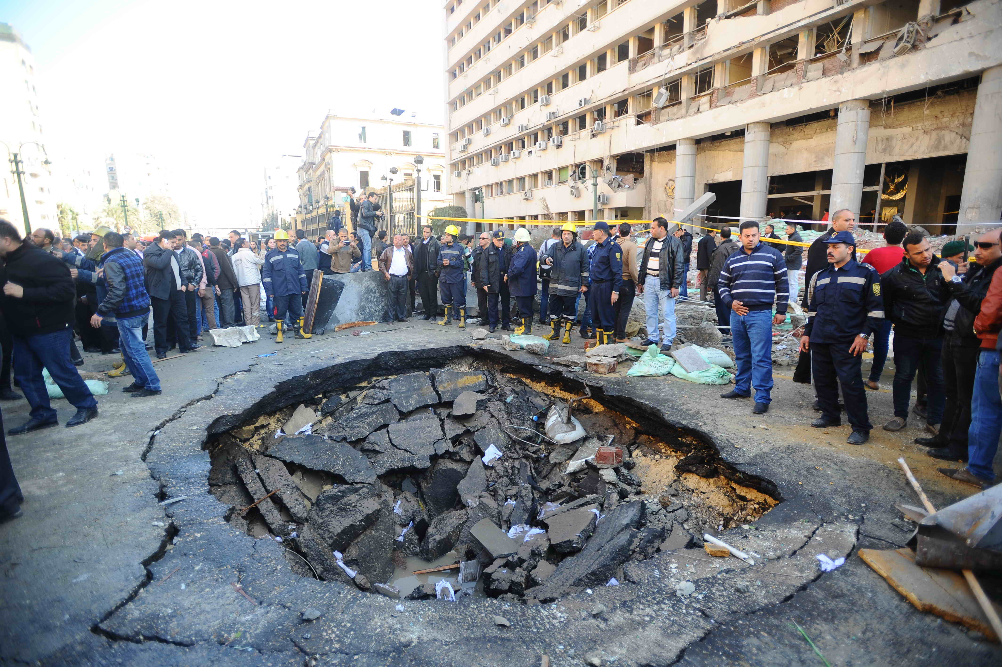 People inspect the crater formed due to the car bomb  which targeted the Cairo Security Directorate  Ahmed Al-Malky
