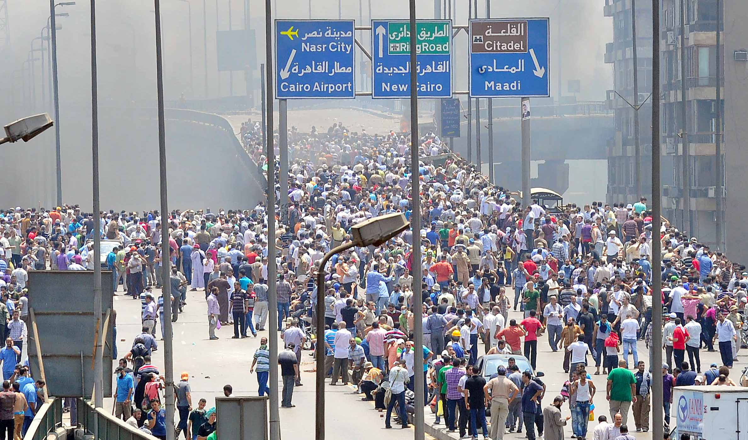 Pro Morsi march to Rabaa after dispersal (Photo by Ahmed AlMalky/DNE)