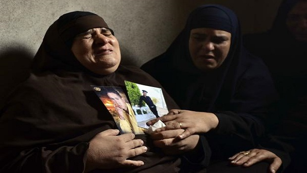 he mother of Egyptian policeman Amr Shebl, who was killed in an attack on two buses packed with Egyptian policemen near the border town of Rafah, in northern Sinai the previous day, is comforted by a relative as she mourns on August 20, 2013.  (AFP PHOTO / MOHAMED EL-SHAHED)