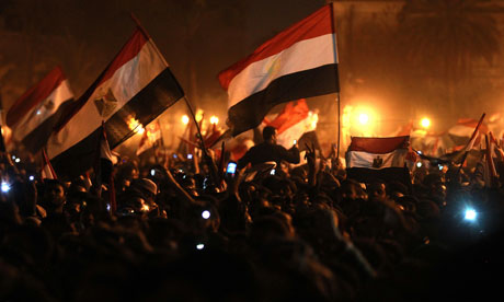 Egyptian anti-government protesters wave flags as they celebrate in Tahrir Square on 11 February, 2011. (Patrick Baz/AFP/Getty Images/File Photo)