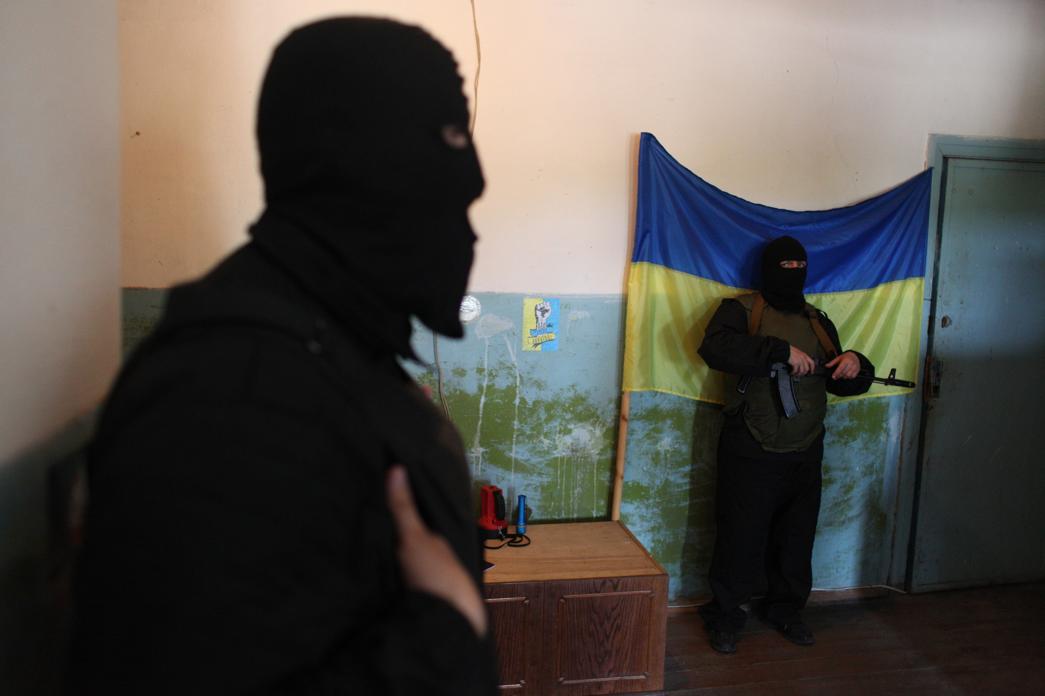 The US and Europe have prepared fresh sanctions on Russia over the crisis in Ukraine, where tensions spiked as rebels detained an international team of military observers. (AFP Photo)
