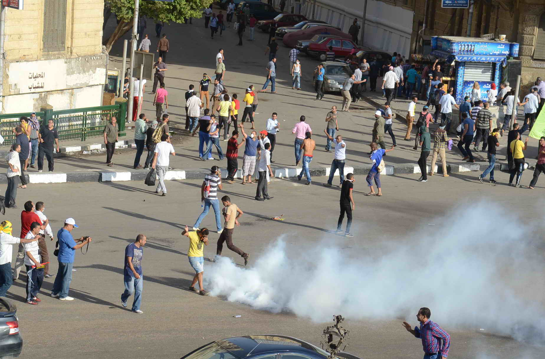Police fired tear gas as clashes erupted between pro Morsi demonstrators and security forces in downtown Cairo on Friday. (Photo by Ahmed AlMalky/ DNE)