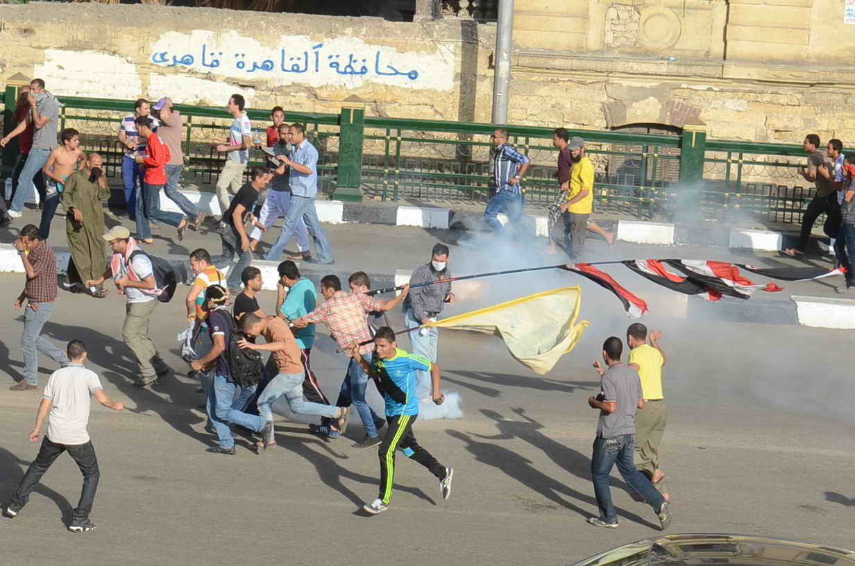 On Friday, clashes ensued between Brotherhood supporters, security forces and citizens.  Five people were reported dead. (Photo by Mohamed Omar/DNE)