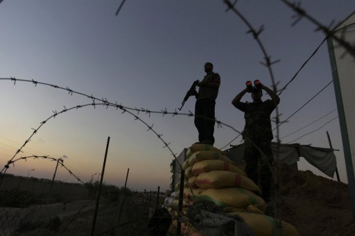 Hamas security guard the border between Egypt and Gaza Strip, in Rafah, on September 11, 2013 (AFP, Said Khatib)