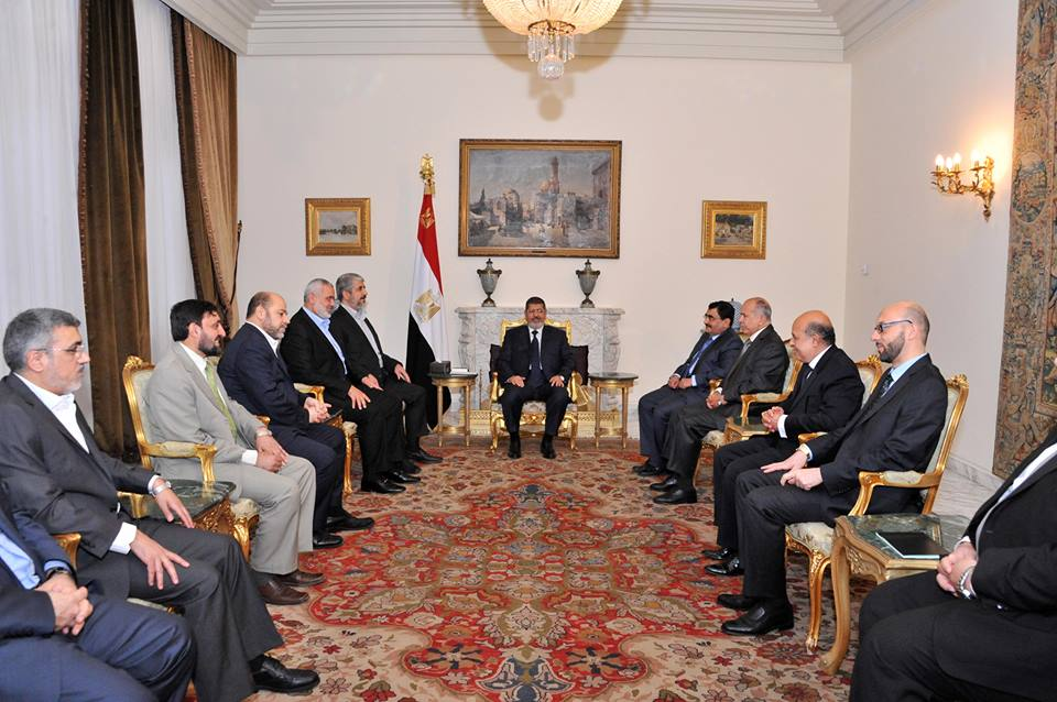 President Mohamed Morsi stressed the necessity of Hamas and Fatah to reconcile for the sake of strengthening Palestine's position in the peace process during a meeting between the two on Monday night. (Photo Presidency Handout)