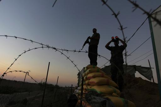 File picture shows Palestinian Hamas security forces guarding the border between Egypt and the Gaza Strip, on September 11, 2013  (AFP/File, Said Khatib)