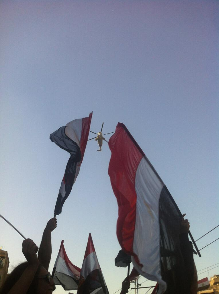 """As low-flying military helicopters circled overhead, marchers waved flags and cries of """"long live Egypt"""" erupted through the crowds (Photo by Aaron T. Rose/DNE)"""