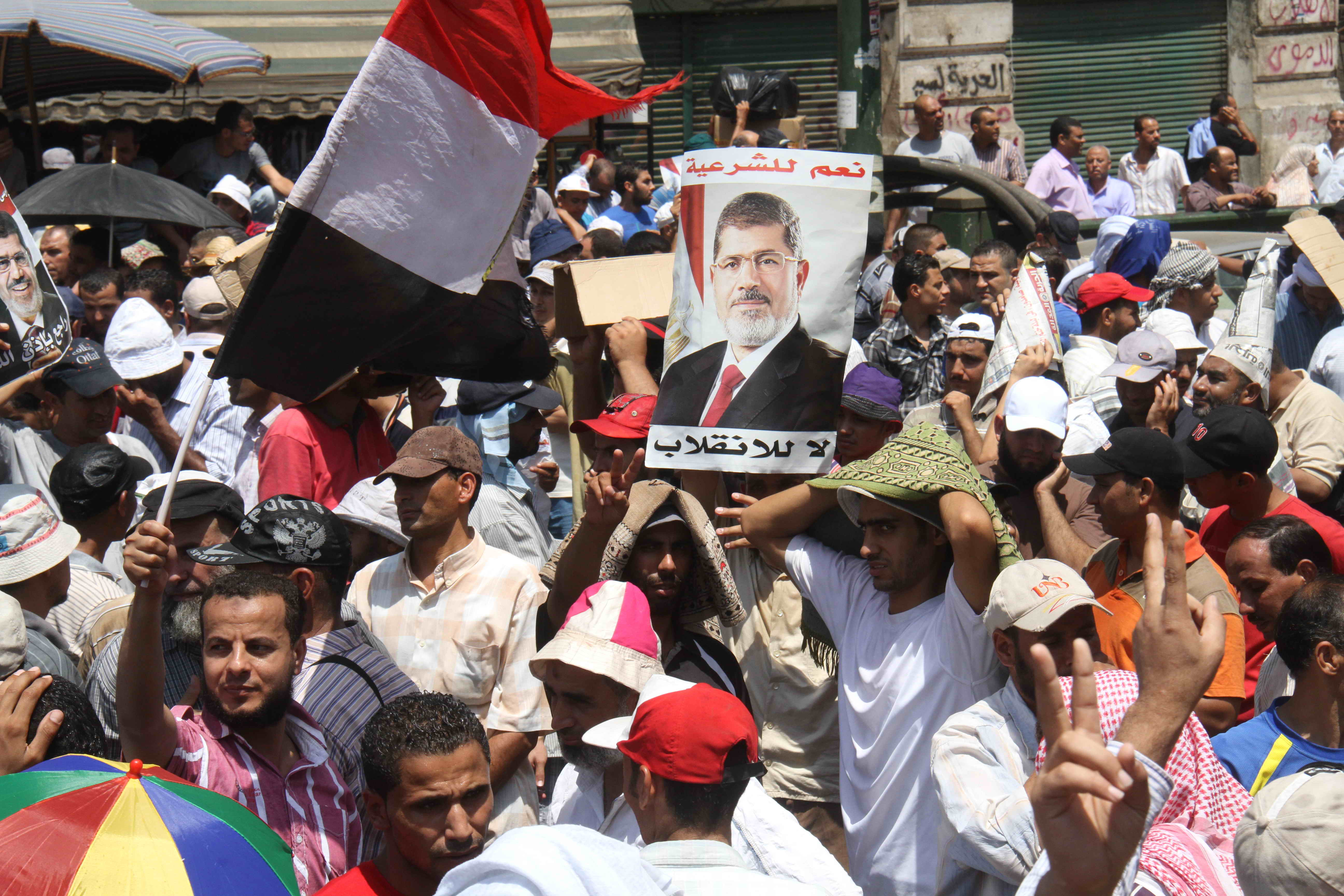 """Thousands of supporters of ousted president Mohamed Morsi marched to Cairo's High Court on Monday, to demand the return of the deposed president, the release of prisoners and in general protest of the """"military coup"""". (Photo by Mohamed Omar)"""