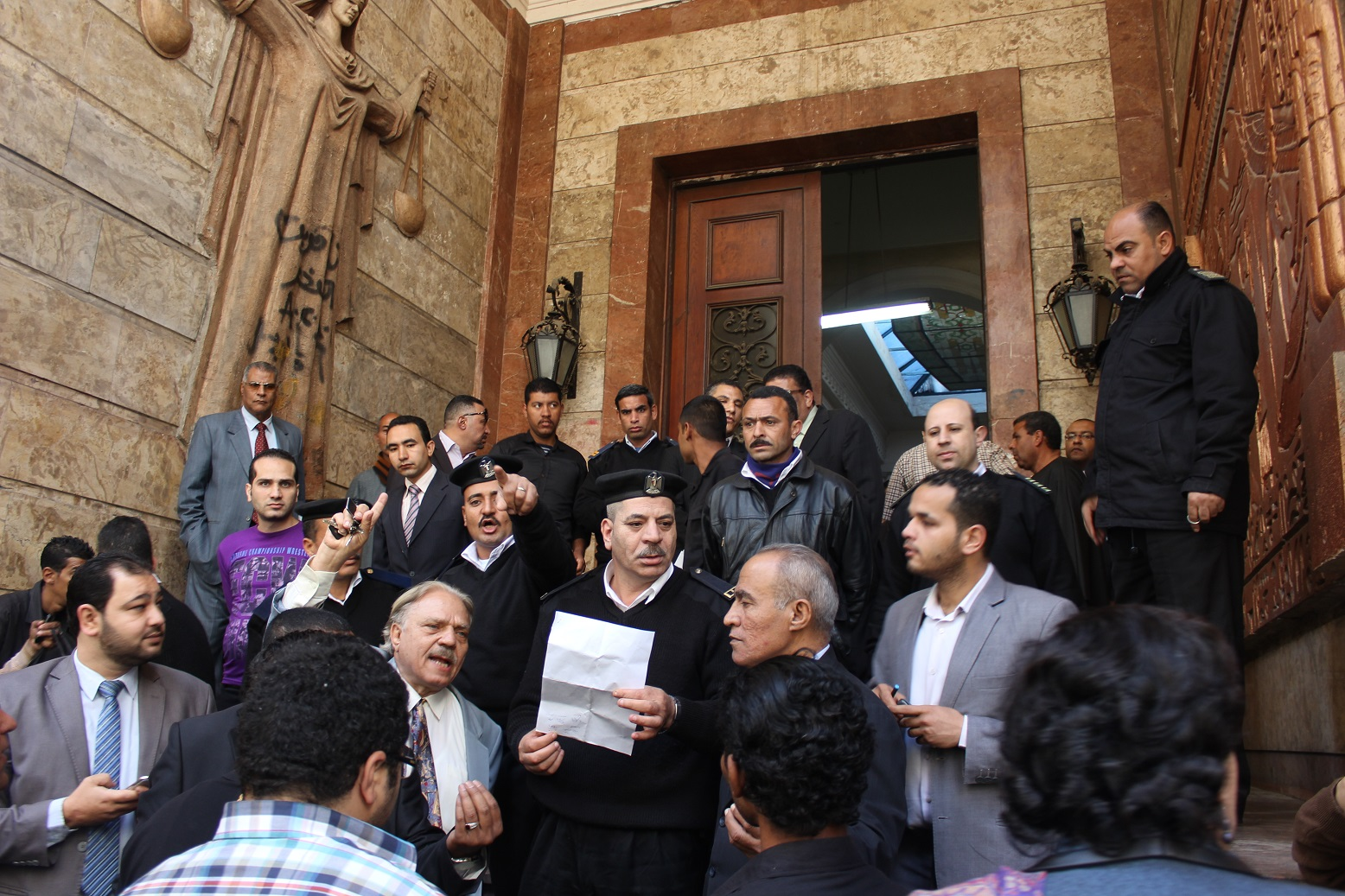 Dozens of journalists and lawyers gathered Saturday morning in front of the Abdeen Court, Downtown Cairo, ahead of the first trial session in the controversial killingcaseof Shaimaa Al-Sabbagh. (Photo By Emir Nader)