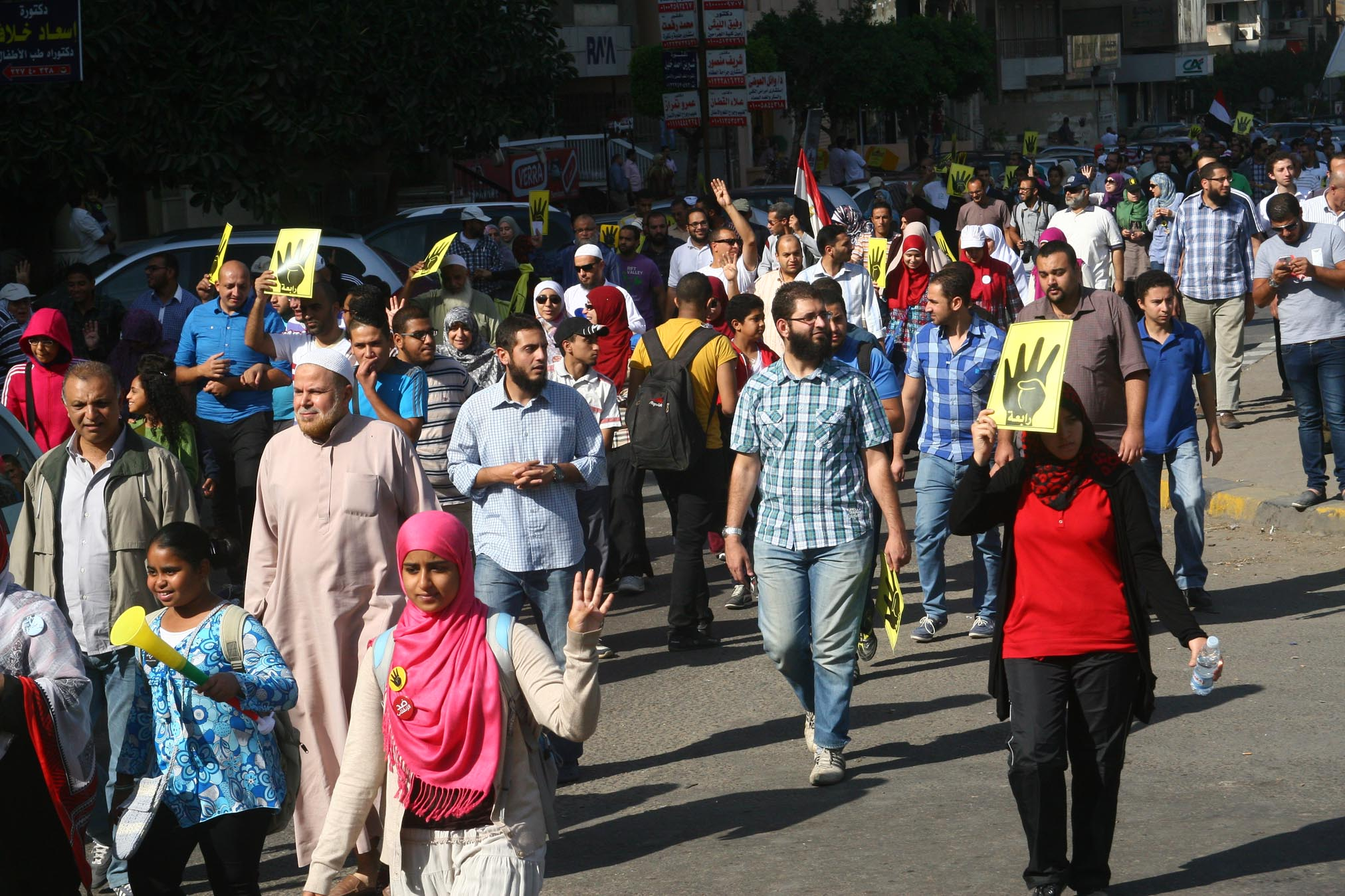 "Morsi supporters march in several governorates in Egypt on Friday under the banner ""No to retaliatory Justice"". Photo from a Cairo march.  (Photo by Mohamed Omar/DNE)"