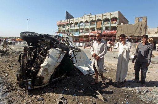 The site of a car bomb in the impoverished Baghdad district of Sadr City, on July 29, 2013 (AFP Photo)