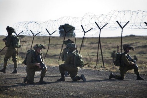 Israeli infantry take part in exercises in the Israeli annexed Golan Heights near the border with Syria on May 27, 2013 (AFP/File, Menahem Kahana)