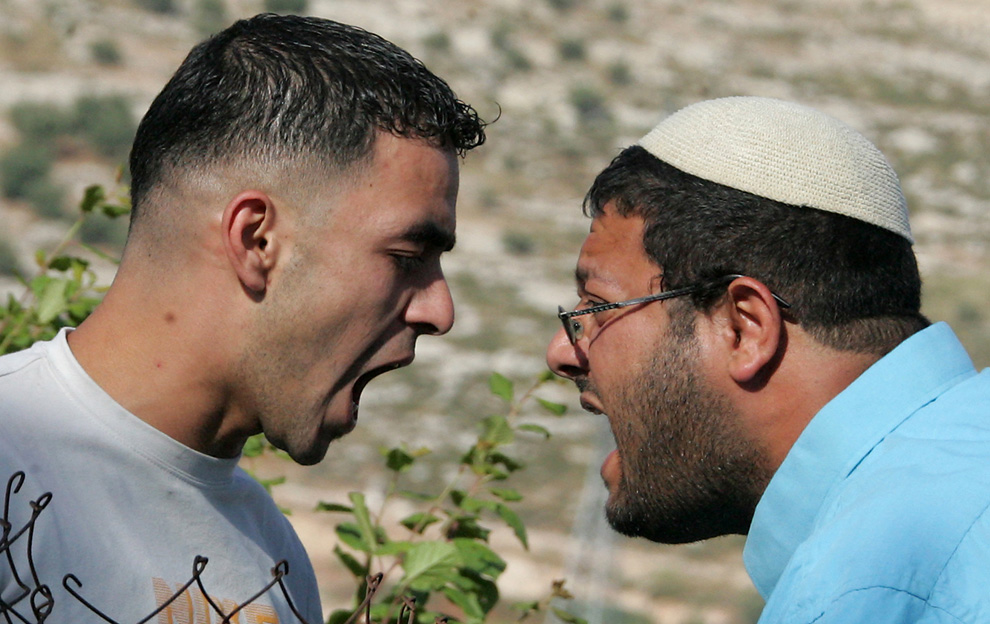 A Jewish settler argues with a Palestinian demonstrator during a protest against an Israeli settlement in the West Bank city of Hebron in 2009. (HAZEM BADER/AFP File)