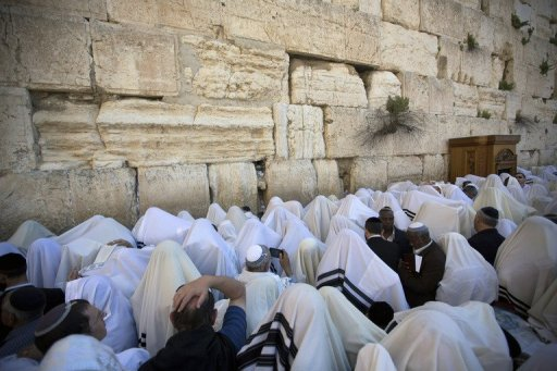 Jewish men pray at the Western Wall in the Old City of Jerusalem (AFP/File, Menahem Kahana)