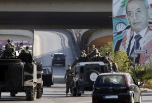 Lebanese army troops patrol the airport highway on the southern outskirts of Beirut on August 9, 2013 (AFP, Anwar Amro)