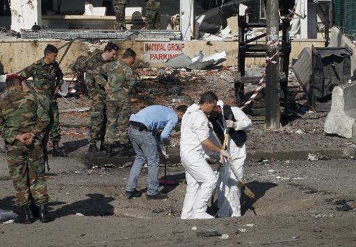 Lebanese forensic experts pictured working in the aftermath of an explosion in Beirut's southern district of Bir Hassan on February 20, 2014