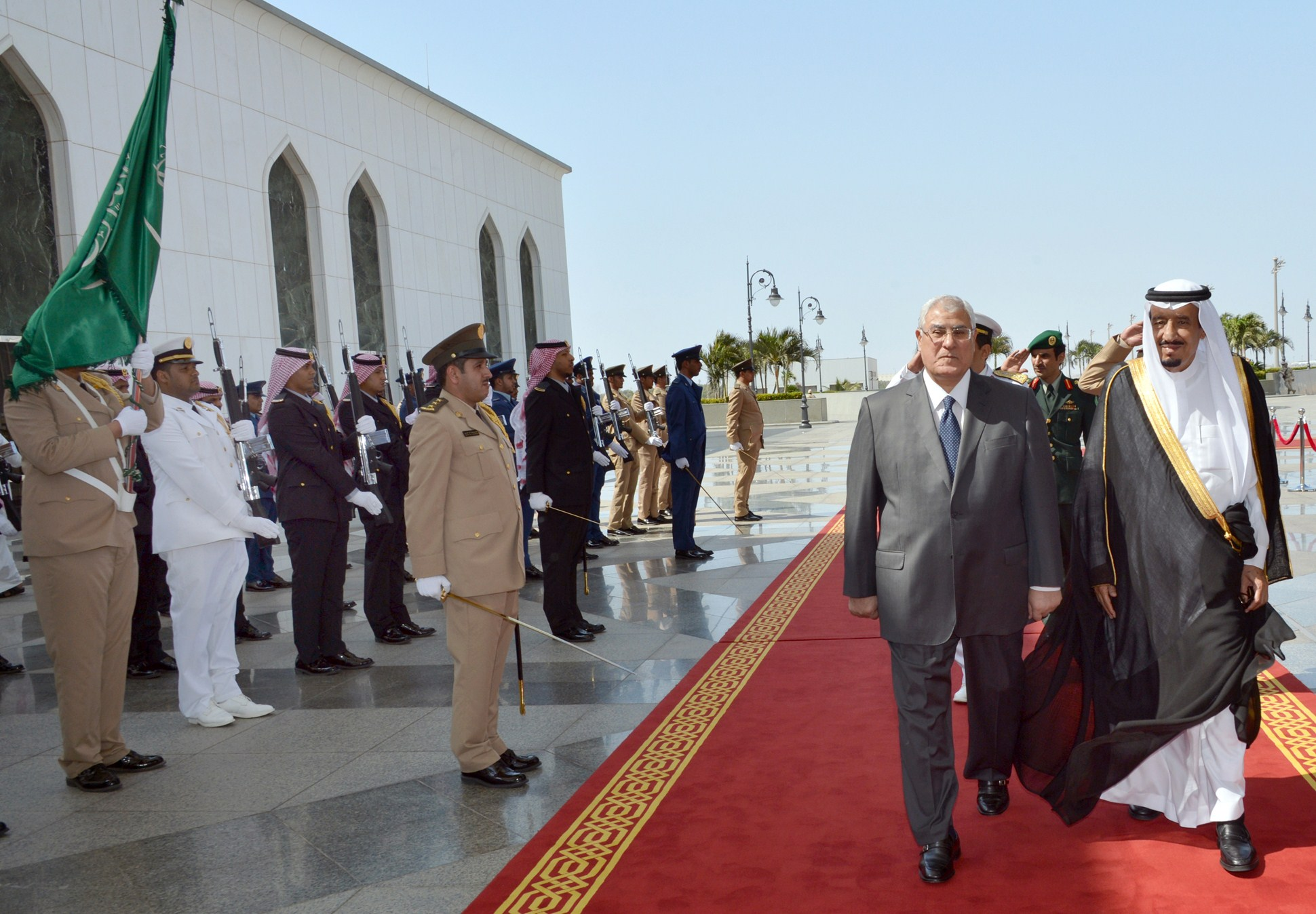 A handout picture released by the Saudi Press Agency (SPA) shows Saudi's Crown Prince Salman bin Abdul Aziz al-Saud (R) and Egypt's interim president Adly Mansour (2R) reviewing the honour guard on October 7, 2013 following the latter's arrival in Jeddah on his first foreign trip since being appointed to replace Egypt's ousted Islamist leader Mohamed Morsi.  (AFP PHOTO )