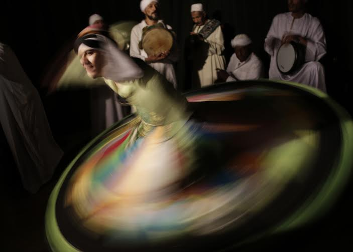 A whirling dervish circumambulates with Al-Tannura Egyptian Heritage Dance Troupe at El Dammah theatre  (Photo by Amr Nabil)
