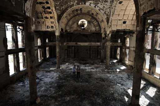 Coptic Christians talk on August 27, 2013 inside the burned Amba Moussa church in Minya (AFP, Gianluigi Guercia)