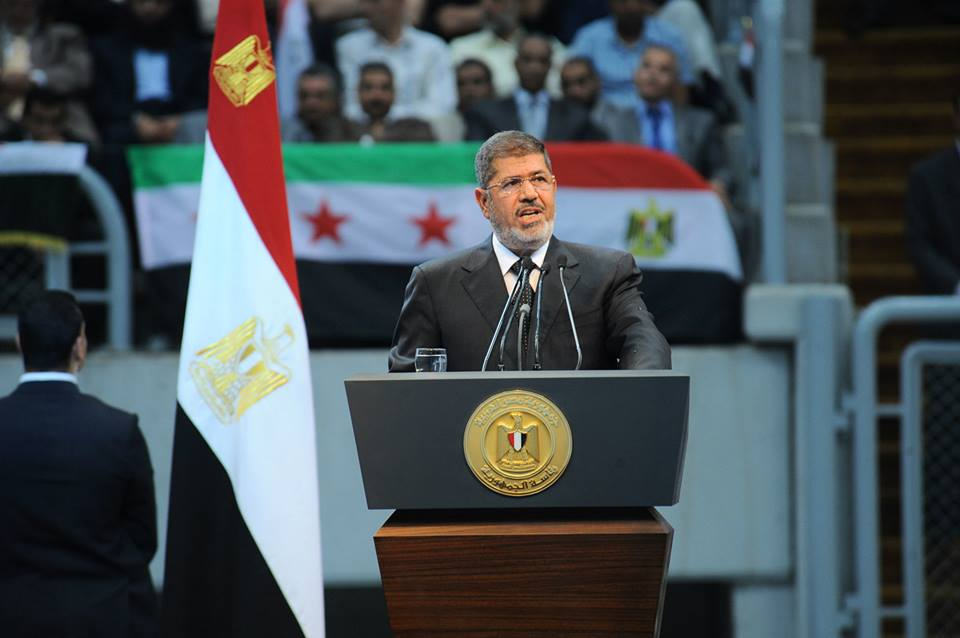 President Mohamed Morsi delivers a speech during the National Conference for the Support of the Syrian Revolution  )Photo Presidency handout)