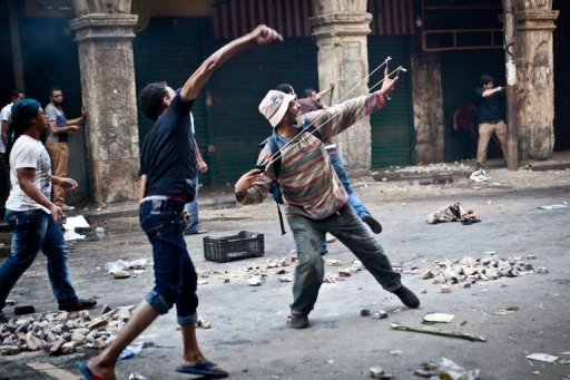 Supporters of ousted president Mohamed Morsi throw stones in Cairo's Ramses Square, on August 16, 2013 (AFP, Virginie Nguyen Hoang)
