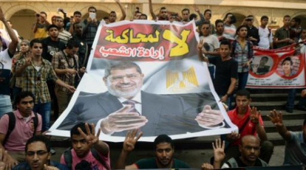 A supporter of Egypt's deposed Islamist president Mohamed Morsi is pictured outside the police academy in Cairo on 4 November 2013 (AFP/File)