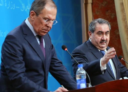 Russian Foreign Minister Sergei Lavrov (L) and his Iraqi counterpart Hoshyar Zebari give a joint press conference following a meeting in Baghdad on February 20, 2014