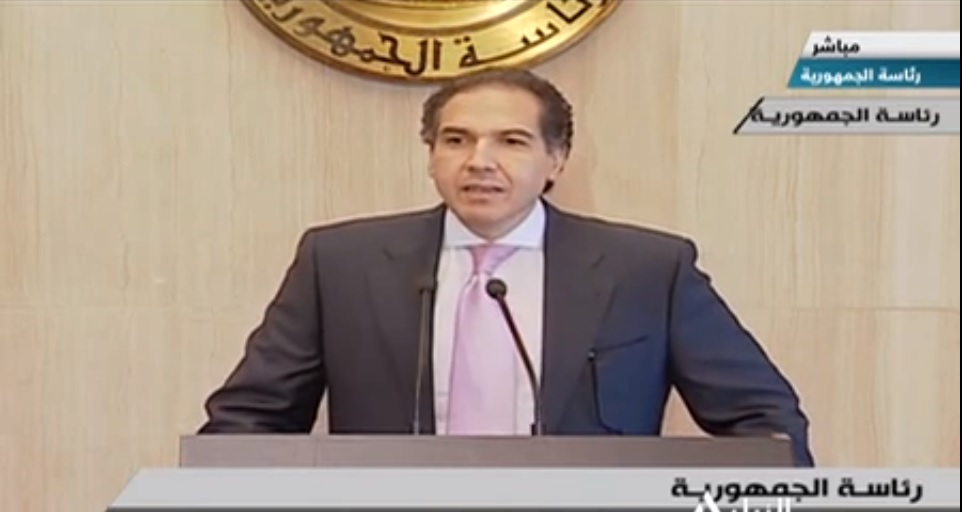 Presidential adviser for political affairs, Mostafa Higazi, speaking at the press conference (Screegrab from the televised conference)