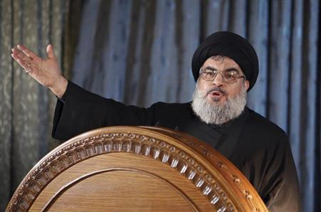 Lebanon's Hezbollah leader Nasrallah addresses his supporters in a rare public appearance on the eve of Ashura in Beirut's southern suburbs on 13 November 2013. (Reuters Photo/Hasan Shaaban)