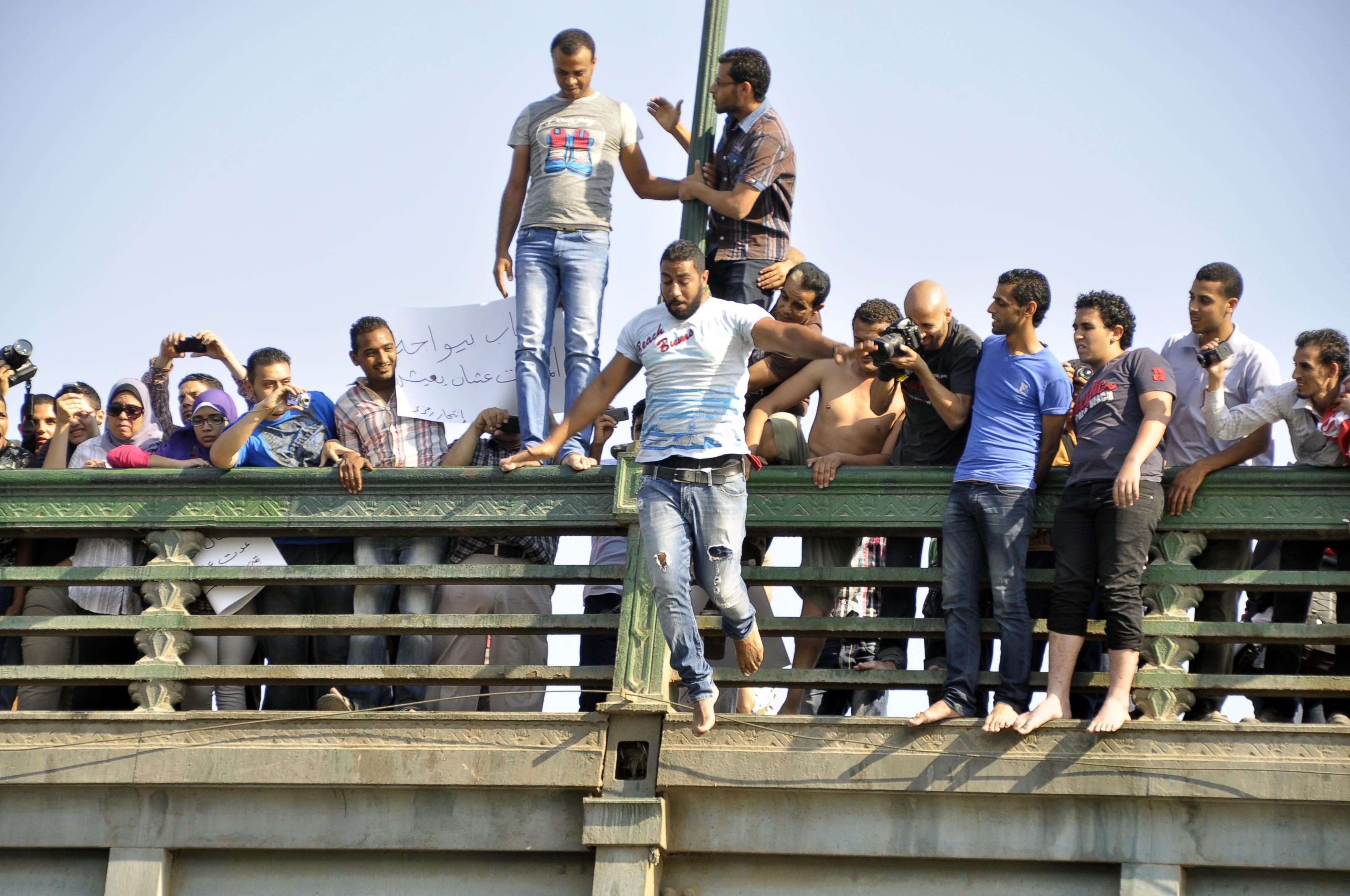Approximately eight protesters jumped off the Qasr Al-Nil Bridge into the Nile river in a show of protest against Morsi (Photo by Ahmed AlMalky/DNE)