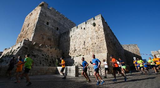 More than 20,000 runners from 50 different countries take part in the annual Jerusalem marathon in the Old City, on March 21, 2014  (AFP, Thomas Coex)