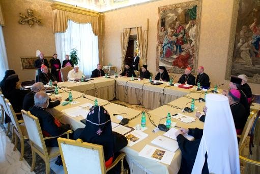 This handout picture released on November 21, 2013 by the Vatican press office shows Pope Francis during a meeting with Patriarchs and Major Archbishops of the Eastern Churches for Syria, Iraq and the Middle East at the Vatican