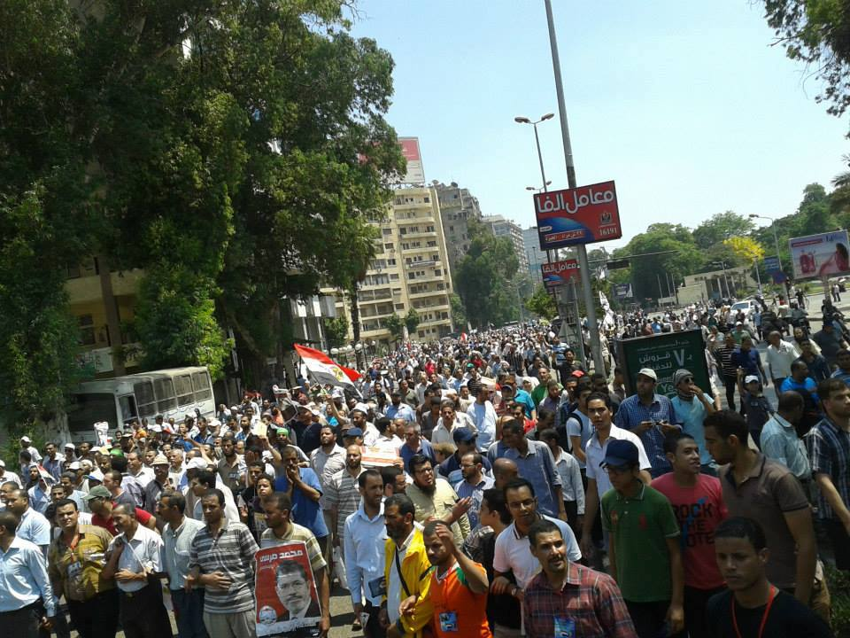 Protesters march in Giza to announce their support for former President Mohamed Morsi- Photo from Freedom and Justice Party's Facebook page