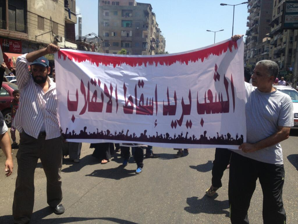 Pro Morsi demonstrators march from Shubra to Rabaa, where the three-week long sit in is held (Photo by Basil El Dabh/DNE)