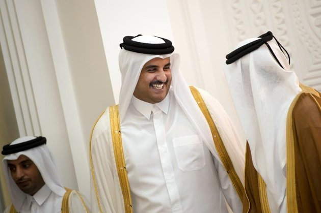 Qatari Crown Prince Sheikh Tamim bin Hamad bin Khalifa al-Thani (C),pictured in Doha on June 23, 2013