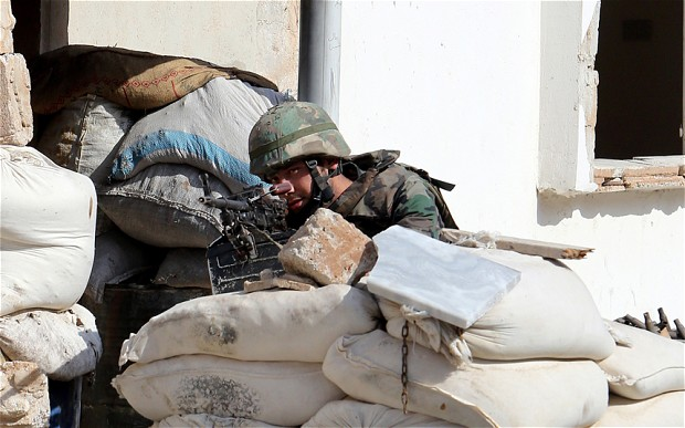 Syrian state television said troops and Hezbollah fighters had captured the Arjun district in the north of Qusayr on Thursday (AFP Photo)