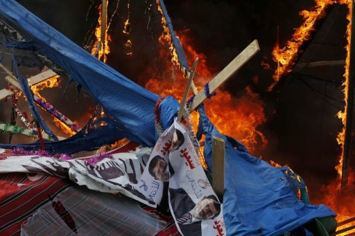 A fire rages in a protest tent as security forces move to disperse Morsi supporters by force in Cairo, August 14, 2013 (AFP/File, Mohammed Abdel Moneim)