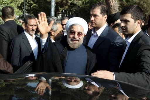 Hassan Rowhani waves after visiting the tomb of Ayatollah Ruhollah Khomeini in the south of Tehran on August 24, 2013 (Iranian President's office/AFP/File)