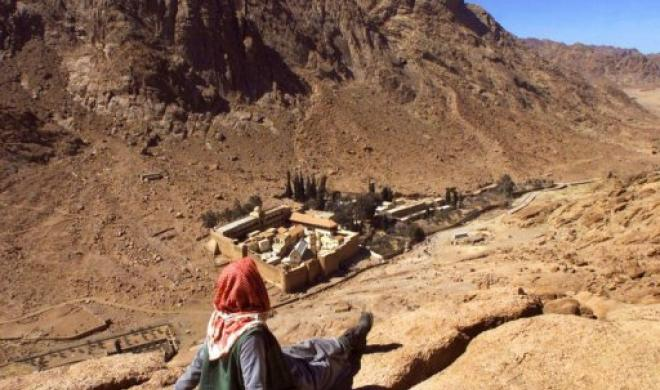 An Egyptian Bedouin pictured looking towards the Catherine monastery at the foot of Mont Sinai