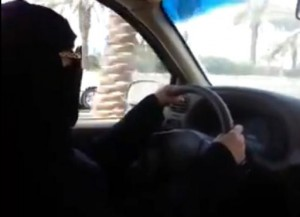 An image grab taken from a video uploaded by Saudi activists on YouTube on October 17, 2013 shows a fully veiled woman driving in Riyadh ahead of a planned nationwide day of defiance of the ban on women driving (YouTube/AFP/File)