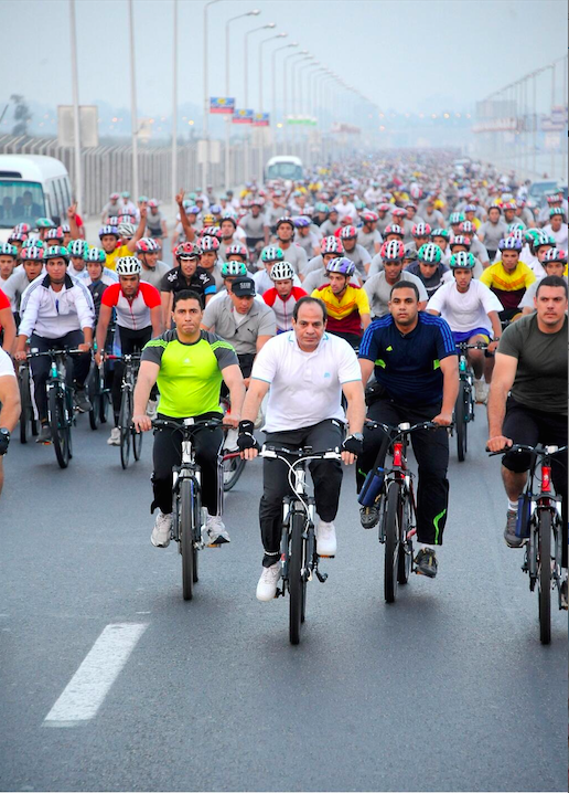 President Abdel Fattah Al-Sisi participates in a cycling event on Friday morning. (Photo by Mohamed Samaha/Handout from the Presidency)