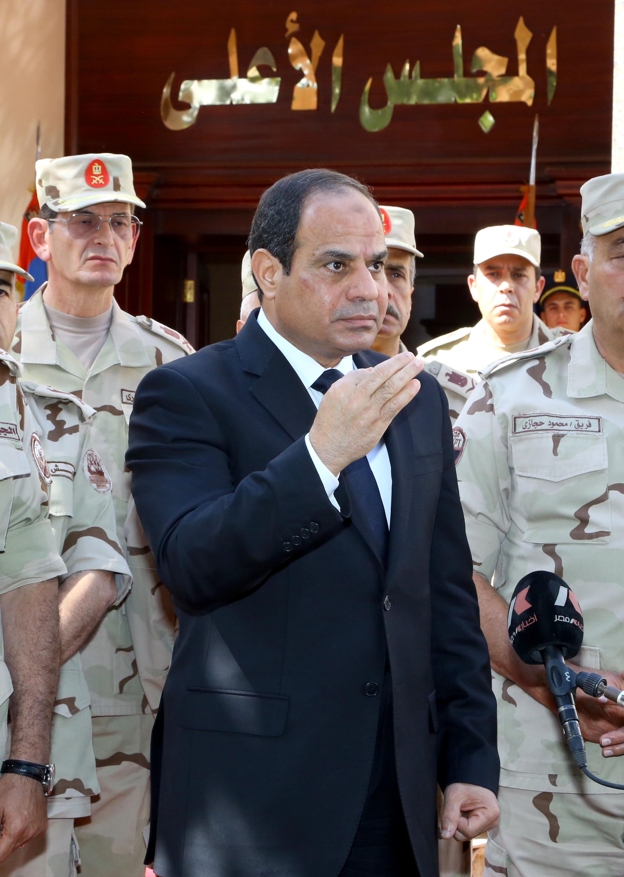 President Abdel Fattah Al-Sisi attending the military funeral of the at least 30 army personnel who were killed last Friday in Sinai violence. (Photo Armed Force Handout)