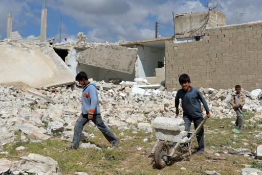 Syrian children collect materials from destroyed houses in Azaz on 21 April 2013 (AFP, Miguel Medina)