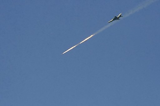 A Syrian warplane fires at a target in the northern Syrian city of Raqqa on March 6, 2013 (AFP/File, Mohammad al-Hussein)