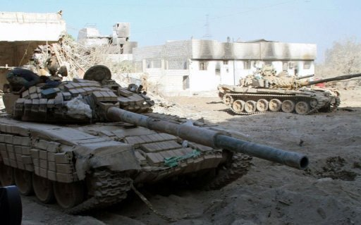 Syrian army tanks are seen deployed in the Jobar neighbourhood of Damascus on August 24, 2013 (AFP/File)