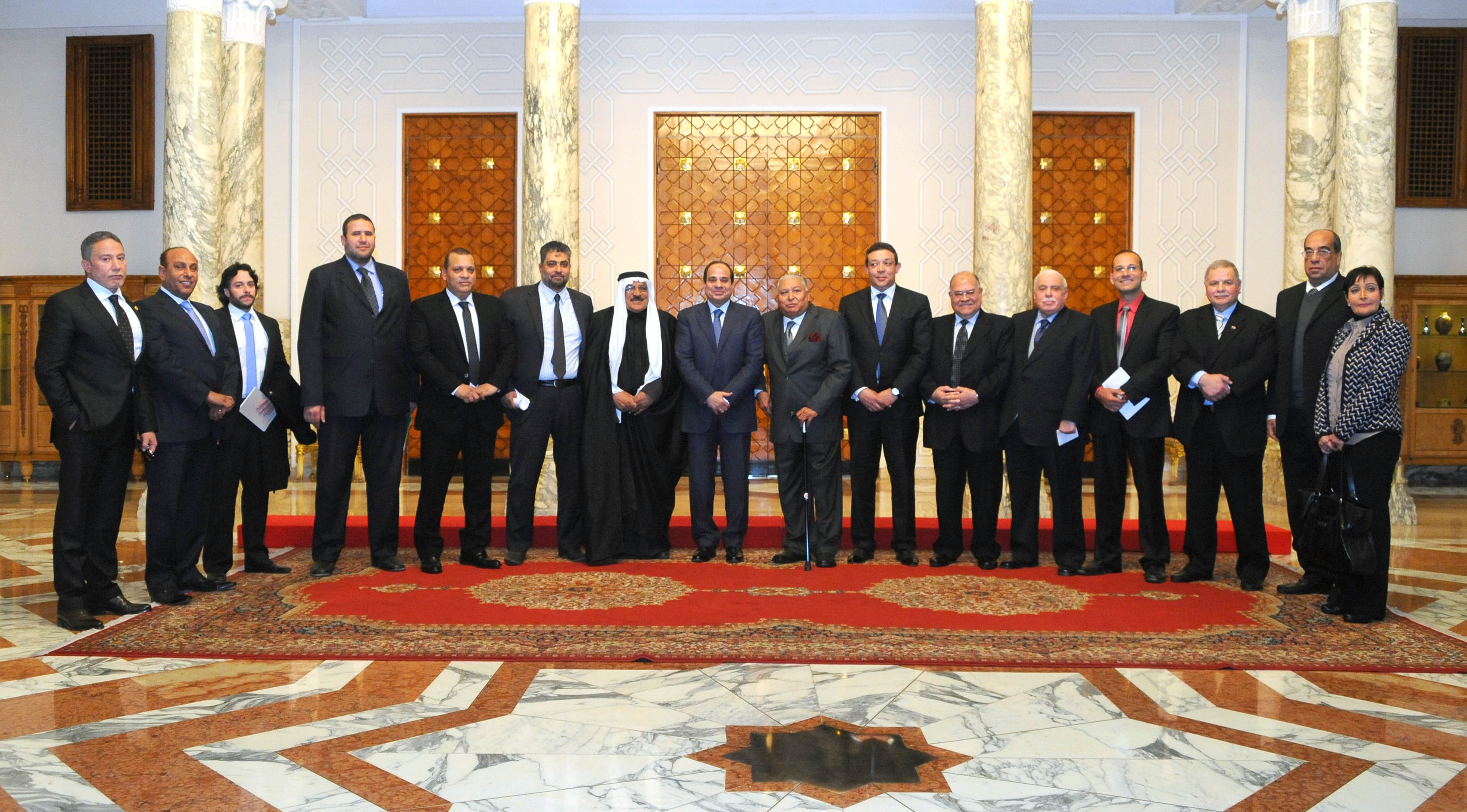 President Abdel Fattah Al-Sisi stands among leader of political parties in Egypt, in the first official meeting since he was sworn in as president. The meeting extended over Monday and Tuesday ahead of the parliamentary elections of 2015.  (Photo Presidency Handout)
