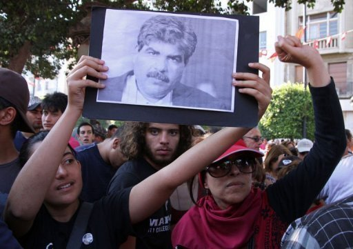 Tunisians hold a portrait of slain opposition politician Mohamed Brahmiin Tunis on July 25, 2013 (AFP, Khalil)