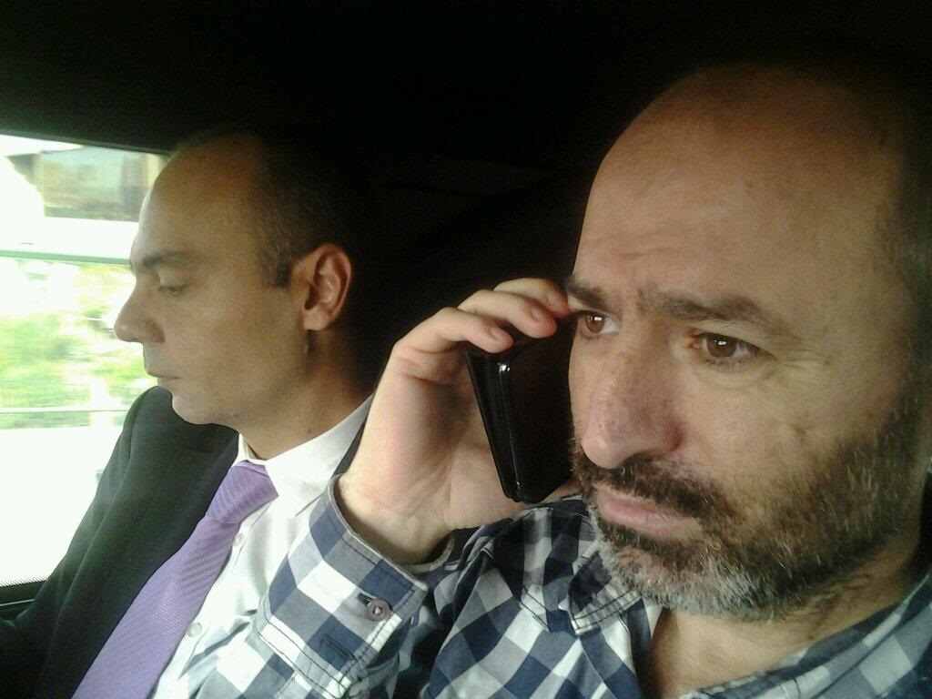 Turkish journalist Metin Turan (right) was released by Egyptian authorities on Monday and met by Turkish Charge d'Affairs Alper Bostur (left) (Photo courtesy Hakan Celik)