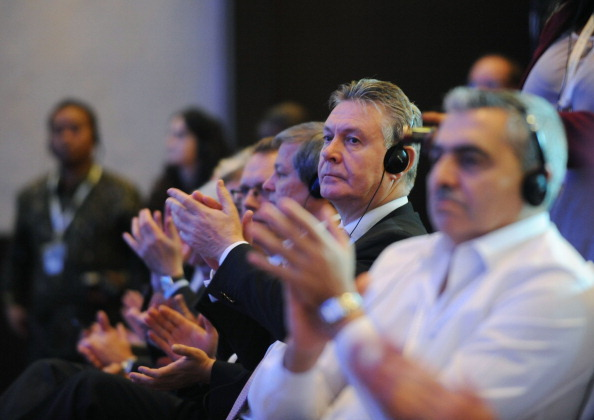 Union (EU) Commissioner Karel De Gucht (2nd R) applauds during the closing ceremony after success with final agreement of the WTO (World Trade Organisation) conference in Nusa Dua, on Indonesian resort island of Bali on December 7, 2013.  (SONNY TUMBELAKA/AFP/Getty Images)