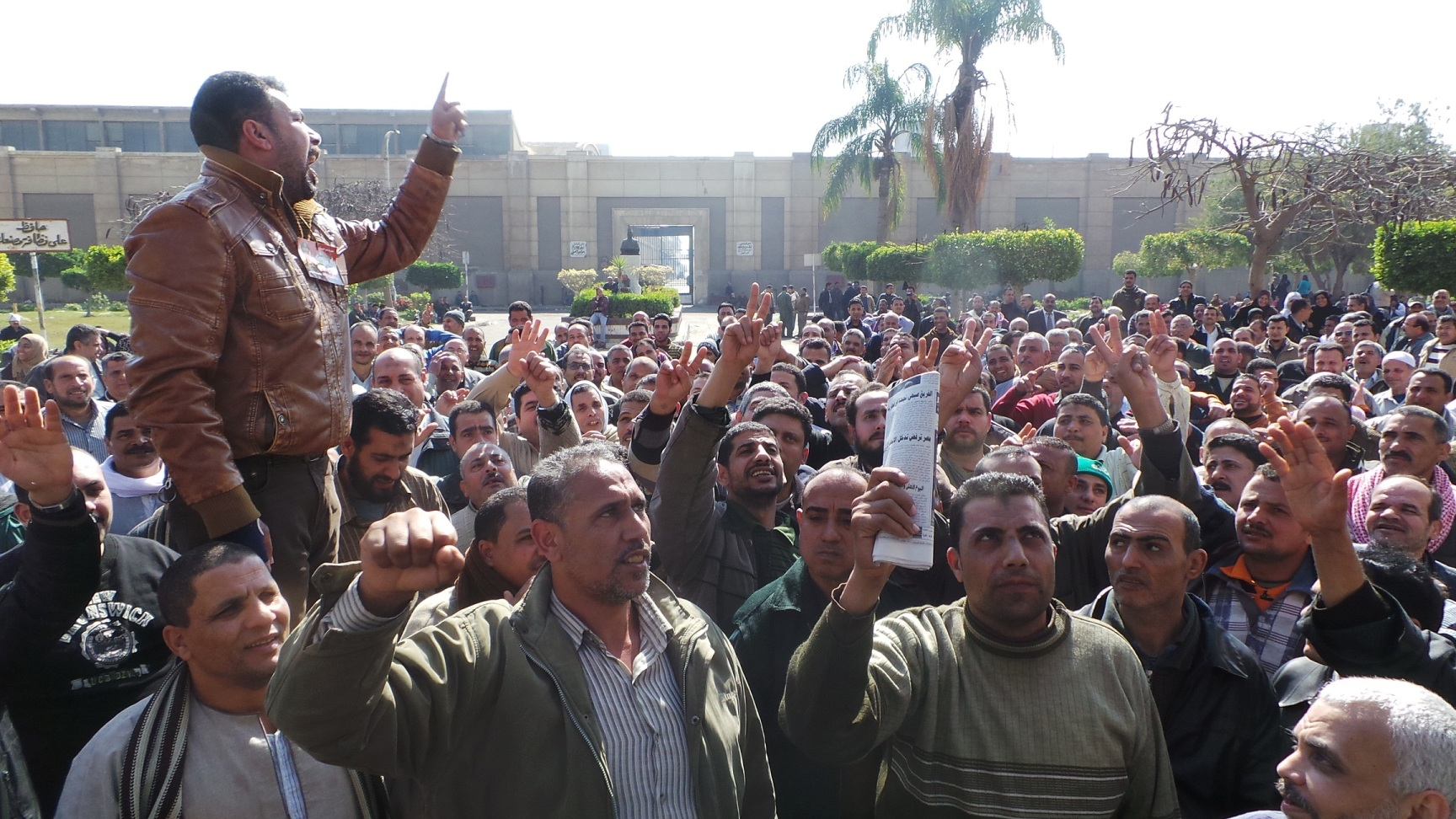 Mahalla Weaving Company workers strike on 11 February, demanding minimum wage. The governmnet Wednesday said only administrative employees qualify for the plan.  (Photo from Aswat Mareya)